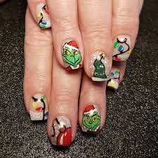 20 christmas nail designs that look like tiny ugly sweaters brit