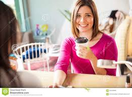 cute young woman drinking tea at a nail salon stock photo image