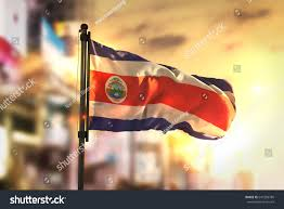 Costa Rico Flag Costa Rica Flag Against City Blurred Stockillustration 641509789