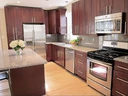 beautiful red color mahogany wood kitchen cabinets featuring black