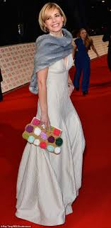 darcey bussell earrings pom pom clutch bags are the new fashion accessory you must