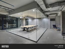 luminous conference zone in the office in a loft style with brick