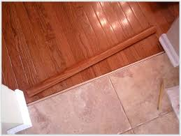 transition between the tile wood floorstile to floor