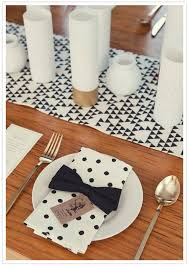 gold polka dot table cover we love mixing patterns on the table recreate this look using black