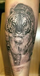 grey ink tiger on thigh leg by turyanskiy