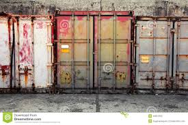 grunge urban interior with old cargo containers stock photo