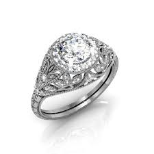 hand crafted custom vintage art deco style halo diamond ring by