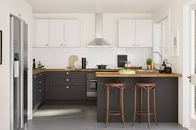 kitchen with white cabinets and wood countertops diy countertop refinishing tips and tricks to renew the