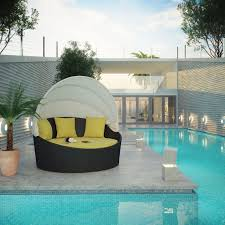 exterior black round day bed with white folding canopy and yellow
