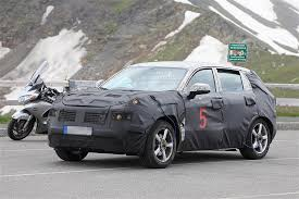 geely geely is testing a new suv in the alps it might be ugly
