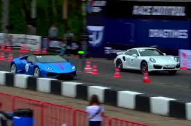 vs porsche 911 turbo a lamborghini huracan race a porsche 911 turbo s
