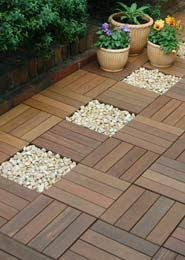 ikea runnen hack ikea decking squares for using in the bathroom with rocks under and