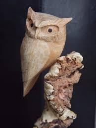 fair trade carved parasite wood carving owl nest cockatoo bird