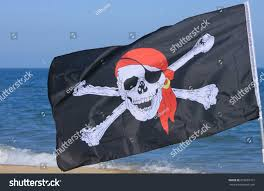 Position Of Flags Jolly Roger Pirate Flag Closeup On Stock Photo 672607312