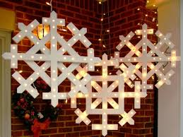 How To String Lights On Outdoor Tree Branches by How To Make Wooden Snowflakes With Lights How Tos Diy