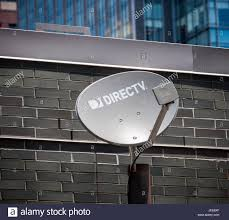 a directv satellite dish on the rooftop of a building in new york