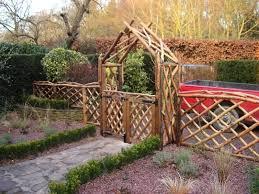 buy ornamental garden steel arch bench brown at argoscouk argos