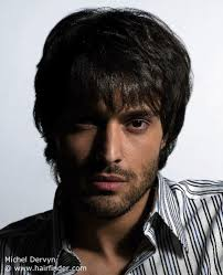 men feathered hair men s hairstyle with layering and feathering for a soft silhouette