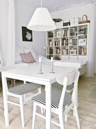 dining area in tiny studio apartment with ikea melltorp table and