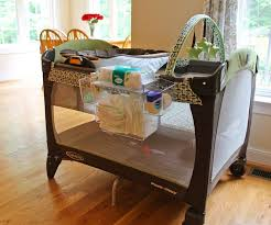 pack n play with changing table so many great ideas for organizing baby s stuff changing station