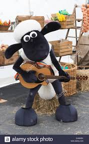 easter plays shaun the sheep plays the guitar kew gardens easter festival