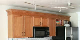 how to add crown molding to kitchen cabinets update builder grade cabinets fast without painting