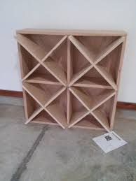 guy creates an awesome wine rack at home using wooden planks