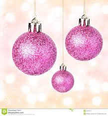 ornaments with shiny festive balls hanging on gold fes