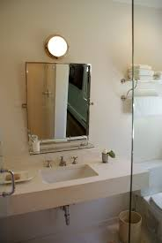 Brushed Nickel Mirror Bathroom by Floating Mitered Slab Vanity Or Two Individual Mirrors Like A