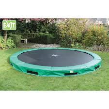outdoor u0026 garden green lawn and in ground trampoline in backyard view