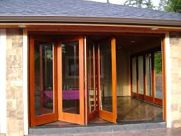 Wooden Bifold Patio Doors Exterior Folding Glass Patio Doors Add More Light To Your House