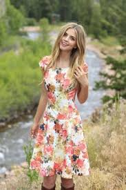 modest floral knee length navy dress red lipstick and a bright