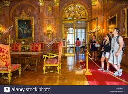 visitors view a formal dining room inside of the marble house on