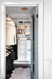 black and white wallpaper lining the back of closet shelves