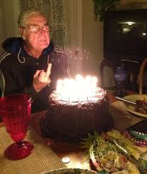 old man gives his birthday cake the middle finger collegehumor post