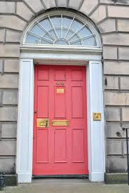 even though this salmon colored front door looks like it could use