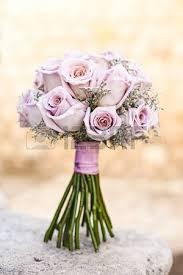 Purple Wedding Flowers The Couple Decided On A Three Layer Wedding Cake Stock Photo
