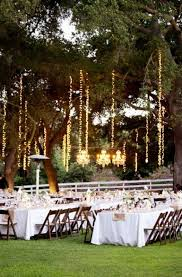 how to hang lights vertically from trees weddingbee boards