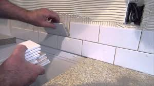 how to install backsplash around outlets how to install
