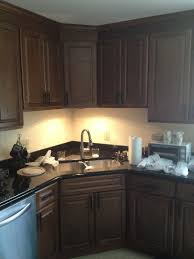 under lighting for kitchen cabinets two poor teachers kitchen remodel corner sink stainless steel