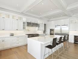 white kitchen island dark cabinets dark polished powder coated