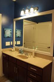 bathroom charming guest bathroom idea with oval mirror and