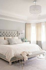 neutral bedroom colors with grey walls and round chandelier and