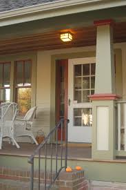 craftsman porch columns with red paneled windows exterior