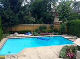 interlocking pool deck with privacy fence m e contracting
