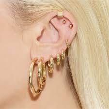 ear piercing hoop 8 things to consider before getting your next ear piercing coveteur