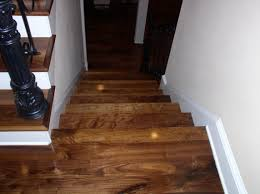 wide plank solid hardwood flooring tiles in stairs with white wall