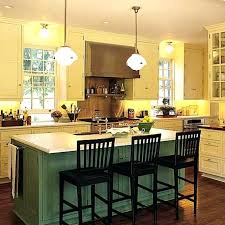 kraftmaid kitchen island green cabinets green kitchen island kraftmaid green