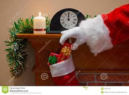 deliver presents santa claus delivering presents on christmas stock photo