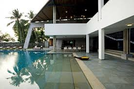 modern luxury home in india boasts an enormous infinity pool